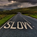 road-in-country-with-slow-sign.jpg